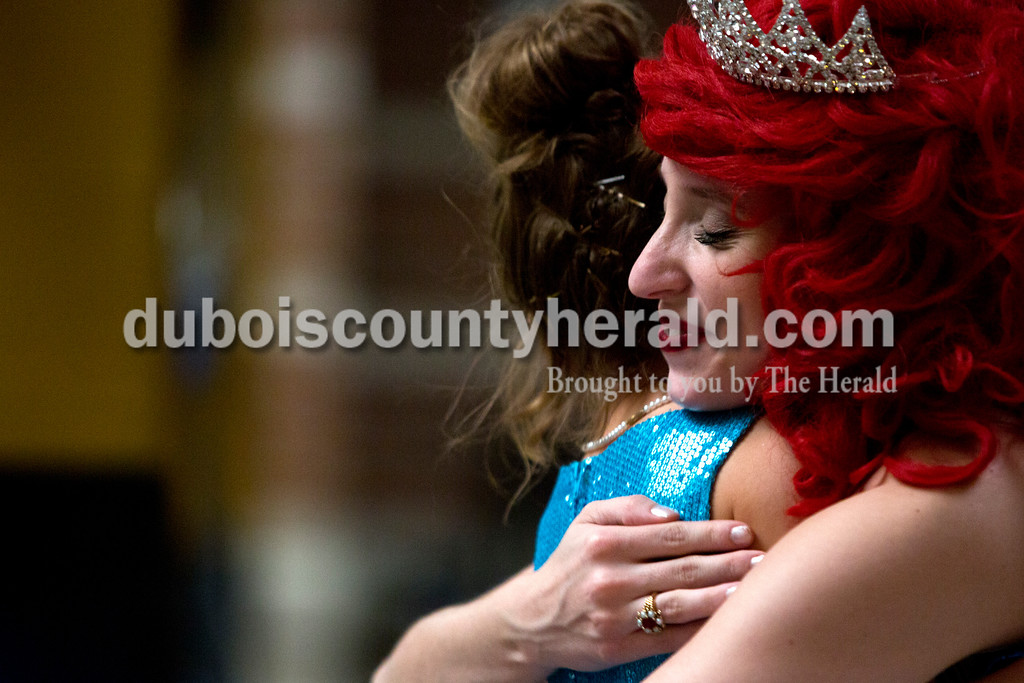Tegan Johnston/The Herald<br /> Event organizer Priscilla Olson of Jasper, 17, dressed-up as Ariel and hugged Mya Uebelhor of Huntingburg, 7, after receiving a prize during Sunday afternoon's Grand Ball at Jasper Middle School in Jasper. Northwood Retirement Community hosted the enchanted event where children dressed-up and were taught to act and dance like real princes and princesses.