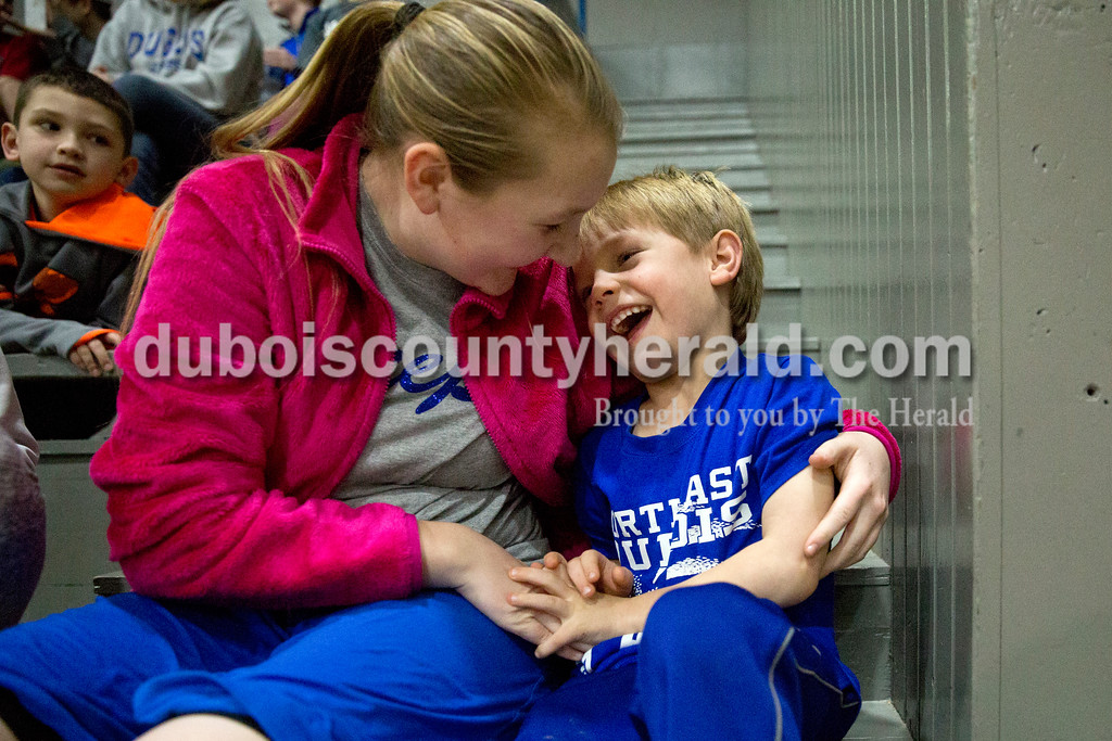 Jeeps fans Macey Harrison, 11, tickled Tucker Woolems, 5, both of Dubois, during Monday's girls basketball game at Dubois Middle School. Northeast Dubois defeated Shoals 55-21. Sarah Ann Jump/The Herald