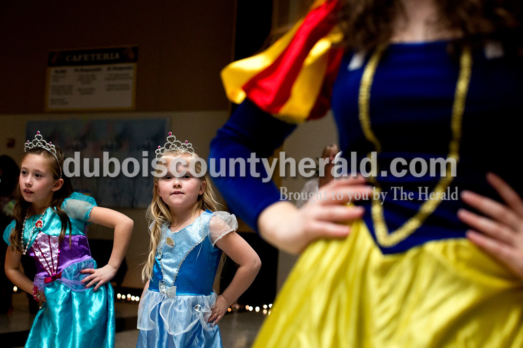 Tegan Johnston/The Herald<br /> From left, Ava Sanders, 8, and her sister Bella, 6, both of Jasper, followed Emma Grow of Jasper, 17, dressed as Snow White, as she danced during Sunday afternoon's Grand Ball at Jasper Middle School in Jasper. Northwood Retirement Community hosted the enchanted event where children dressed-up and were taught to act and dance like real princes and princesses.