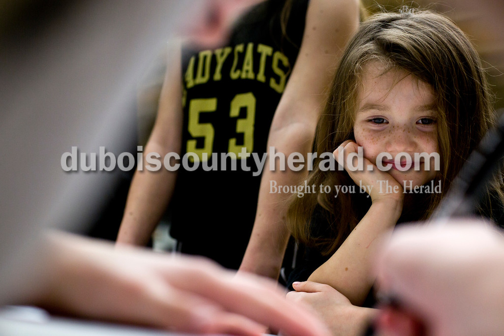Tegan Johnston/The Herald<br /> Jasper's Brooke Nottingham signed a team poster for Taylor Underhill of Jasper, 6, after Saturday afternoon's basketball game at Jasper High School in Jasper. Jasper beat Mt. Vernon 62-25.