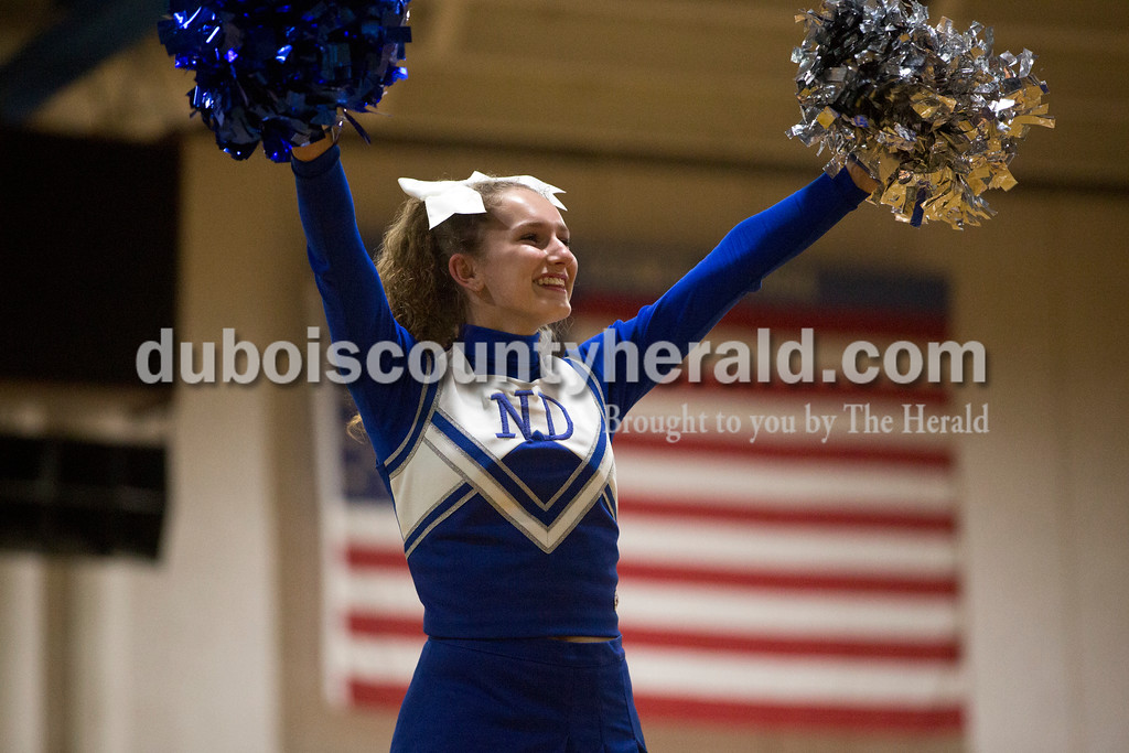 Northeast Dubois sophomore Paige Knies cheered during Monday's girls basketball game at Dubois Middle School. The cheerleaders wore uniforms from the 1990's for throwback night. Northeast Dubois defeated Shoals 55-21. Sarah Ann Jump/The Herald