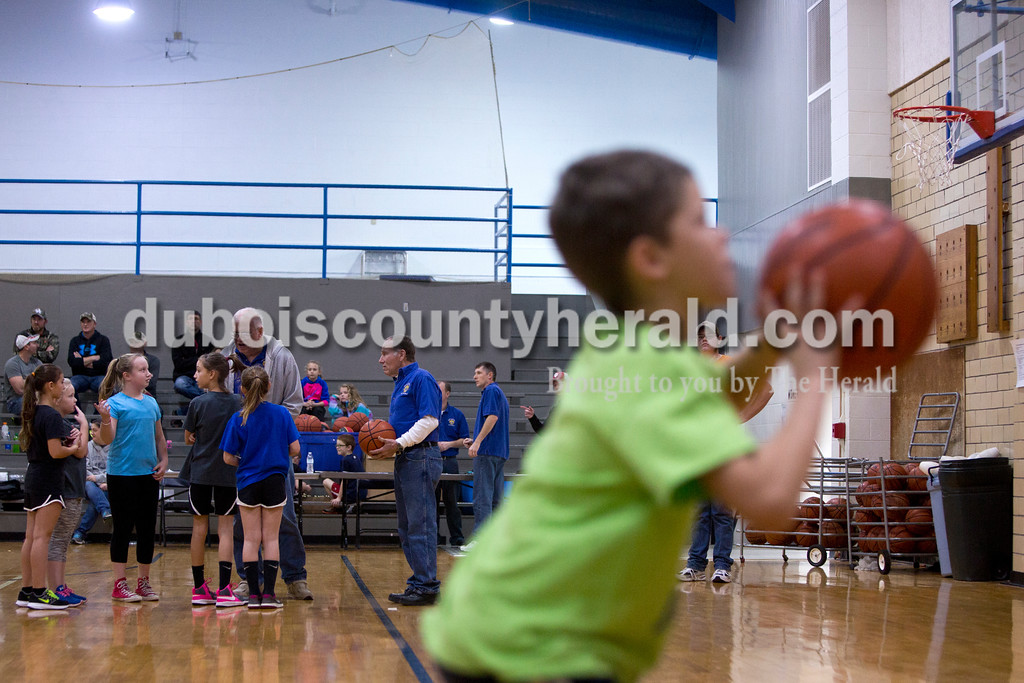 Tegan Johnston/The Herald<br /> Nine-year-old girls lined up to take a free throw shot during Sunday afternoon's Free Throw Competition at Dubois Middle School Gymnasium in Dubois. Over 40 boys and girls competed in different age divisions, and the winners of each age group received a trophy, basketball and the opportunity to advance to the district Knights of Columbus competition in February.