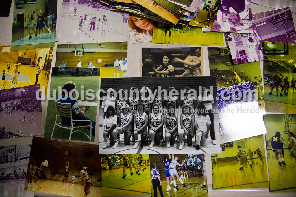 Old photos were put out on display for former players to look through and take as part of throwback night at Monday's girls basketball game at Dubois Middle School. Northeast Dubois defeated Shoals 55-21. Sarah Ann Jump/The Herald