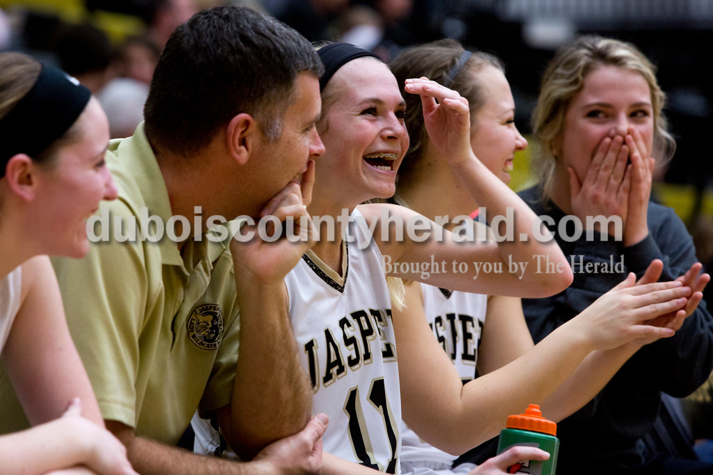 Jasper's Madisyn Hunt, center, laughed while talking to her coach Ryan Erny during Saturday afternoon's basketball game at Jasper High School in Jasper. Jasper defeated Mt. Vernon 62-25. Tegan Johnston/The Herald