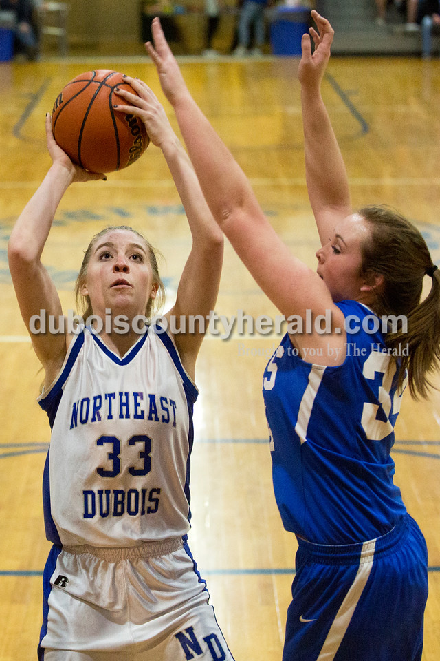 Northeast Dubois' Clare Mangin shot as Shoals' Hope Self defended during Monday's girls basketball game at Dubois Middle School. Northeast Dubois defeated Shoals 55-21. Sarah Ann Jump/The Herald