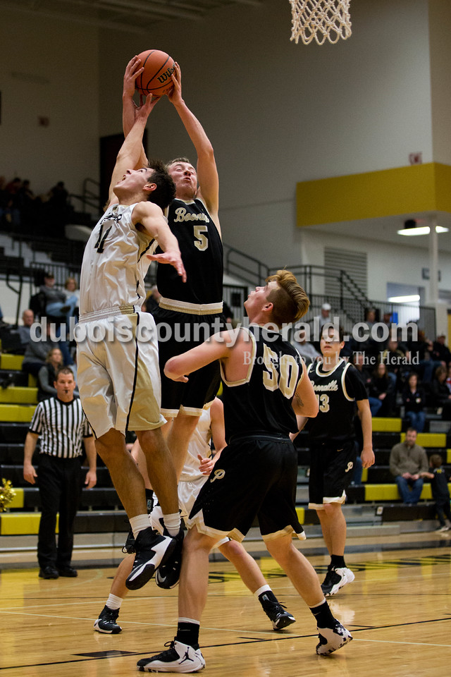 Jasper's Jared Englert jumped to block Boonville's Glen Rouch from retrieving a rebound during Tuesday's basketball game in Jasper. Jasper defeated Boonville 69-59. Sarah Ann Jump/The Herald