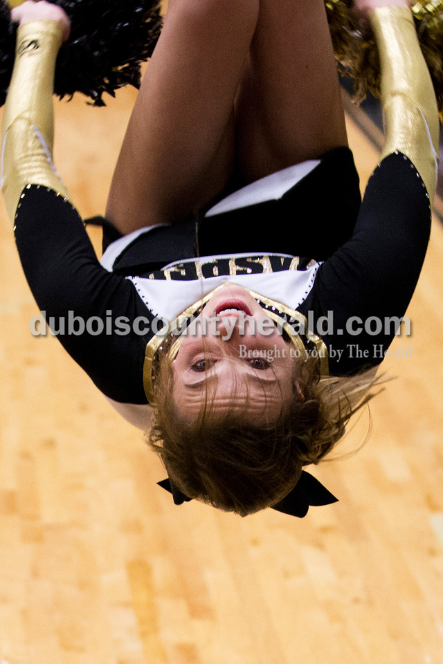 Jasper High junior Jessica Mehringer performed a back tuck as she cheered during Tuesday's basketball game in Jasper. Jasper defeated Boonville 69-59. Sarah Ann Jump/The Herald
