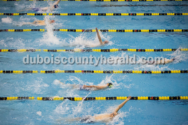 Bedford North Lawrence's Jacob Werley, top lane, Heritage Hills' Austin Schnuck, Southridge's Christian Motteler, Bedford North Lawrence's Andrew Swenson, Pike Central's Jacob Bohnert and Evan Marchino competed in the 100-yard backstroke during Saturday's boys swimming sectional in Jasper. Sarah Ann Jump/The Herald