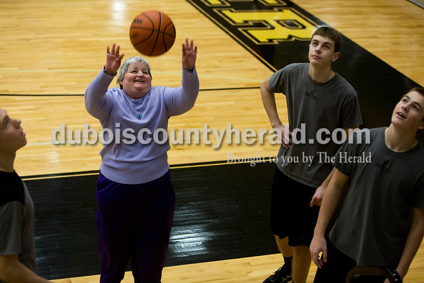 Tegan Johnston/The Herald Kathy Schroering of Jasper took a shot as Jasper players watched during a local Special Olympics activity hosted by Jasper High School's Business Professionals of America and the boys basketball team on Saturday afternoon at Jasper High School in Jasper. The Special Olympic athletes shot hoops and participated in various activities with the Jasper players.