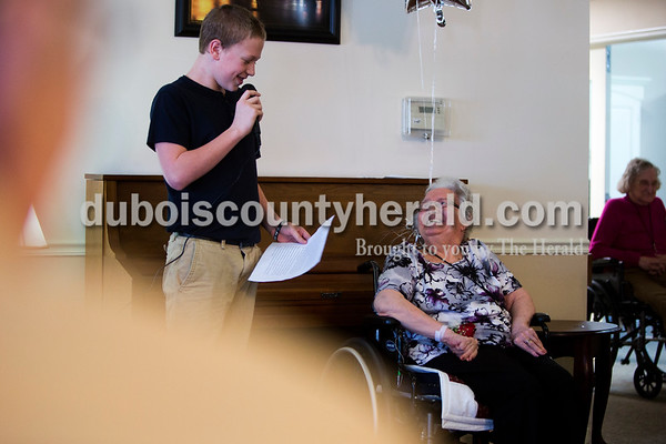 Tegan Johnston/The Herald Jasper Middle School eighth-grader Amos Buschkoetter shared what he learned about Brookside resident Rita Seng during a Jasper Middle School ROOS Club event Sunday afternoon at Brookside Village Senior Living Community in Jasper. The middle schoolers met with their residents three times over a three month span to interview them and to hear their life stories. After the three months, the middle schoolers shared what they learned about the resident they had been paired with in a roughly five minute presentation.