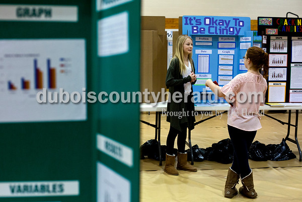 Tegan Johnston/The Herald Jasper Middle School sixth-grader Marissa Killion, left, practiced presenting her project to fellow sixth-grader Rachel Hollinden before the annual science fair at Jasper Middle School Wednesday morning in Jasper. Students presented their projects to judges throughout the day and an overall 6th, 7th, 8th and invention winner will be announced tomorrow evening at 6:30.