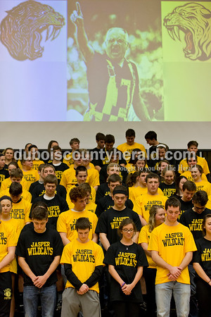 The Jasper student section wore gold and black shirts and arranged themselves to form the vertical stripes in honor of Frankie Ebenkamp's overalls during a moment of silence for Ebenkamp, who passed away last week, before Tuesday's basketball game in Jasper. Jasper defeated Princeton 55-52. Sarah Ann Jump/The Herald
