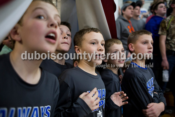 From left, Brock Werner, 11, Colby Lockard, 11, Ty Kalb, 12, all of Dubois, Brayden Beck, 12, and Peyton Betz, 12, both of Celestine, watched as the score was tied during Friday's homecoming basketball game in Dubois. The boys are all part of the Dubois Middle School sixth-grade basketball team, which was honored at halftime. Northeast Dubois defeated Loogootee 58-56. Sarah Ann Jump/The Herald