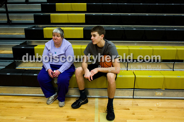 Tegan Johnston/The Herald Kathy Schroering of Jasper and Jasper's Kyle Hedinger sat on the bleachers and talked during a local Special Olympics activity hosted by Jasper High School's Business Professionals of America and the boys basketball team on Saturday afternoon at Jasper High School in Jasper. The Special Olympic athletes shot hoops and participated in various activities with the Jasper players.