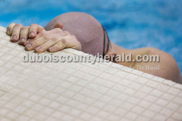 Northeast Dubois' Quinn Dorsam rested in the pool after swimming in the 100-yard backstroke during Saturday's boys swimming sectional in Jasper. Sarah Ann Jump/The Herald