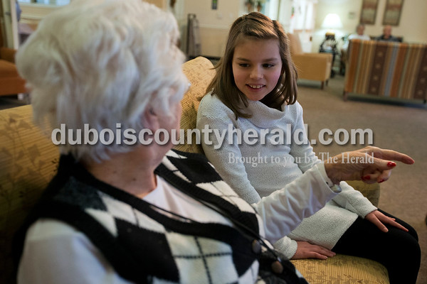 Jasper Middle School seventh-grader Anna Schmitt chatted with Brookside resident Irene Wendholt on Jan. 29 at Brookside Village Senior Living Community in Jasper. Each group of middle schoolers visited the senior they were paired with at least twice throughout the winter before the final event last Sunday.