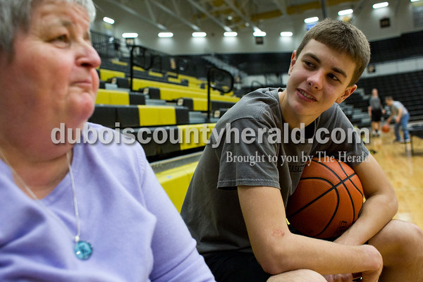 Tegan Johnston/The Herald Jasper's Kyle Hedinger sat on the bleachers and talked to Kathy Schroering of Jasper during a local Special Olympics activity hosted by Jasper High School's Business Professionals of America and the boys basketball team on Saturday afternoon at Jasper High School in Jasper. The Special Olympic athletes shot hoops and participated in various activities with the Jasper players.