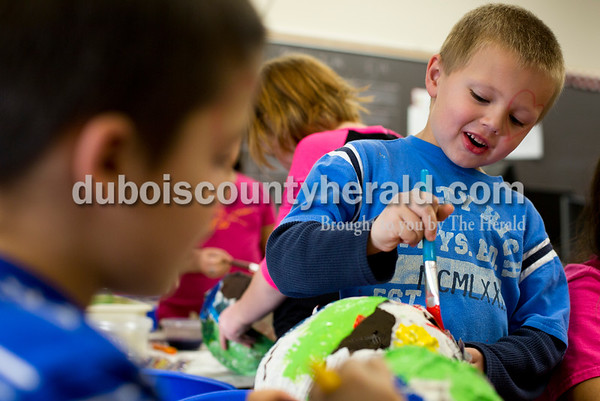 Tegan Johnston/The Herald Huntingburg Elementary School kindergartener Shawn Humpert painted his papier-mâché pinata during a RIDGE art class at Huntingburg Elementary School Tuesday afternoon in Huntingburg. The after-school program offered a variety of clubs that alternate every 3 and a half weeks. Currently, students can choose between cooking, video taping, origami, art and reading clubs.