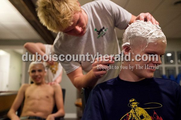 """Alisha Jucevic/The Herald  Jasper High School senior Matt Head shaved his brother sophomore Andrew Head's hair on Wednesday evening in Jasper. """"My hair was so long before,"""" said Andrew. """"This is so weird."""""""