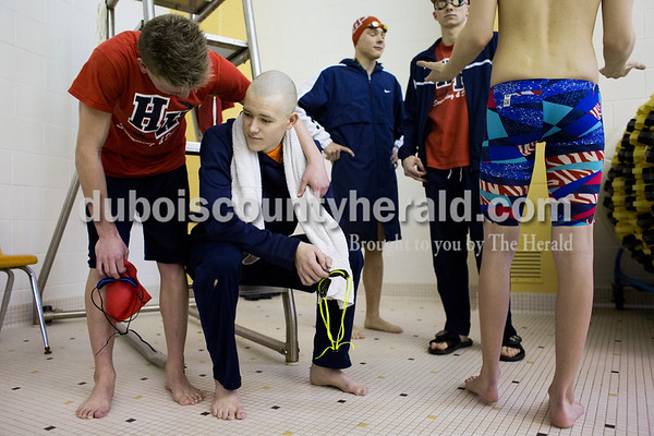 Heritage Hills' Austin Schnuck, left, encouraged Alex Braun before he participated in the 200-yard freestyle relay during Saturday's boys swimming sectional in Jasper. Sarah Ann Jump/The Herald