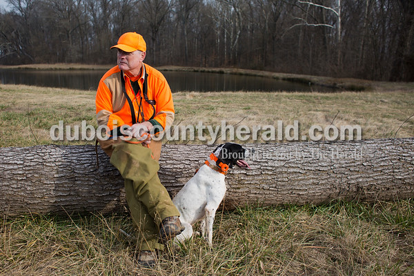 Sarah Ann Jump/The Herald David Hevron of Holland rested with his English pointer Charlie during the Patoka Hills Wes Settle Youth Quail Hunt at Cane Creek Hunting Preserve in Otwell on Saturday.