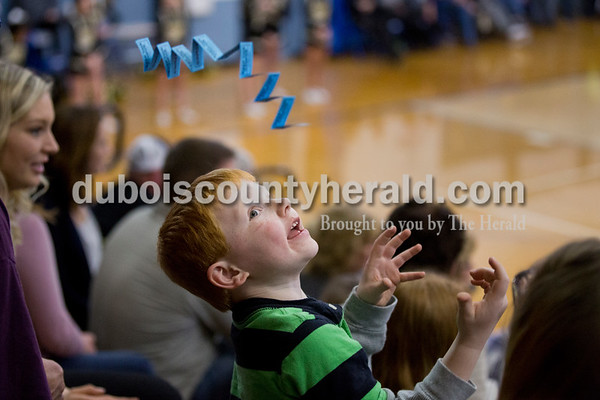Bentley Kluesner of Dubois, 5, threw his half-pot tickets in the air during Friday's homecoming basketball game in Dubois. Northeast Dubois defeated Loogootee 58-56. Sarah Ann Jump/The Herald