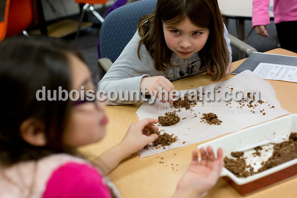 Tegan Johnston/The Herald Huntingburg Elementary School fourth-grader Breezy Serrano, left, and Jaylynn Goodwin ate some of the no bake cookies they helped make during a RIDGE cooking class at Huntingburg Elementary School Tuesday afternoon in Huntingburg. The after-school program offered a variety of clubs that alternate every 3 and a half weeks. Currently, students can choose between cooking, video taping, origami, art and reading clubs.