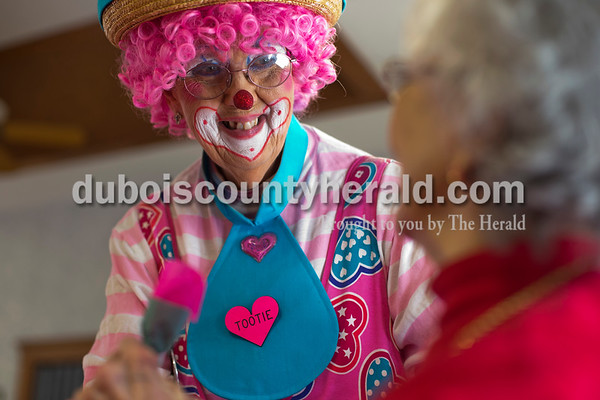 Alisha Jucevic/The Herald   Dressed as Tootie the Clown, Darlene Francone of Jasper entertained  Northwood residents during the Valentine's Day event in Jasper.