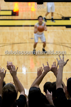 The Jasper student section raised their hands as Austin Simmers made a free throw during Tuesday's basketball game in Jasper. Jasper defeated Princeton 55-52. Sarah Ann Jump/The Herald