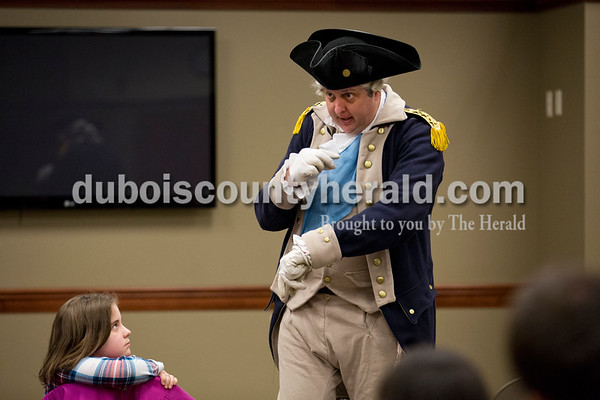 Sarah Ann Jump/The Herald Kaitlyn Meyer of Dubois, 8, watched as George Washington presenter David Wolfe of Owensboro, Ky. gave a presentation about the life of George Washington at the Ferdinand Library on Wednesday.