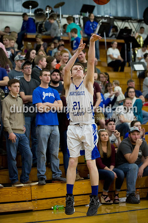 Northeast Dubois' Alex Harder shot a three-pointer during Friday's homecoming basketball game in Dubois. Northeast Dubois defeated Loogootee 58-56. Sarah Ann Jump/The Herald