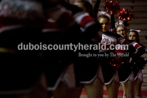 Southridge cheerleader Megan Buechler, second from right, stood in formation and cheered during Friday night's game against Boonville at Memorial Gym in Huntingburg. Southridge defeated Boonville 56-54. Tegan Johnston/The Herald