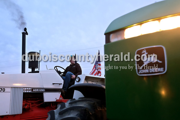 Southridge High School sophomore Masen Cooper revved the engine of the tractor her drove to school Tuesday morning during Drive Your Tractor To School Day. Dave Weatherwax/The Herald