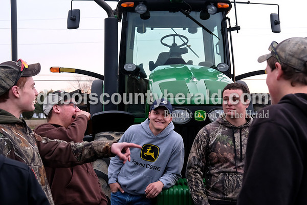 Southridge High School freshman Tanner Brown, from left, seniors Aaron Lubbehuesen, Prestyn Balsmeyer and Tristan Brown recounted their drive to school Tuesday morning in the school's parking lot during Drive Your Tractor To School Day. Dave Weatherwax/The Herald