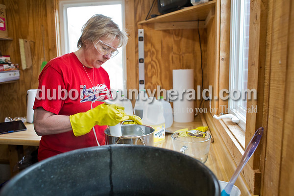 Sarah Ann Jump/The Herald Patty Ruhe mixed a batch of chocolate peppermint soap in her home workshop near Maltersville on Monday. Ruhe owns Forest Fresh in Jasper, where she sells handmade soaps and lotions.