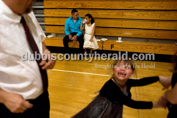 Tegan Johnston/The Herald Jaime Regalado of Jasper sat and talked with his daughter Leslie, 7, as she sipped her drink during the second annual Daddy and Daughter Dance on Saturday evening at Jasper Middle School in Jasper.  Dance Central Academy Parent Club sponsored the event that drew over 300 people.
