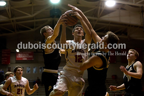 Southridge's Harrison Steckler jumped to take a shot during Friday night's game against Boonville at Memorial Gym in Huntingburg. Southridge defeated Boonville 56-54. Tegan Johnston/The Herald