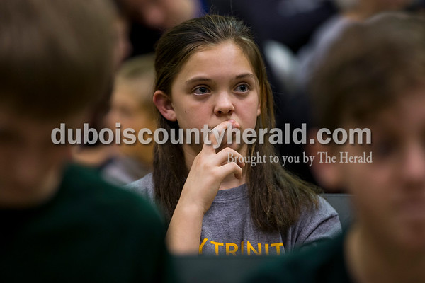 Holy Trinity fifth-grader Lilly Rasche watched her teammates solve a problem during the 21st Annual Indiana Academic M.A.T.H. Bowl at Cedar Crest Intermediate School on Thursday. Holy Trinity won first place in their division after a tiebreaker with Cedar Crest Intermediate.   Alisha Jucevic/The Herald