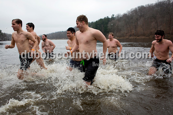Tegan Johnston/The Herald Participants ran out of the lake after plunging into the frigid water during the annual Dubois County Polar Plunge on Sunday afternoon at Ferdinand State Forest in Ferdinand. Proceeds from the event benefitted the Lange-Fuhs Cancer Center, Dubois County Leukemia Association and area food banks.