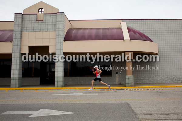 Tegan Johnston/The Herald Donald Schepers of Celestine sprinted outside B&B Fitness during the final seconds of his 4.3 mile run Tuesday morning in Jasper. Schepers is in his first month of training for his third marathon run in Nashville.