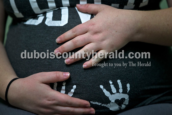 Cortney rested her hands on her belly to feel the baby's movements during a prenatal appointment with Michelle on Jan. 31 in Shoals.