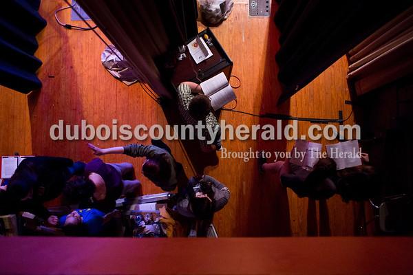 "Southridge High School senior Gavin Deno, center, followed along with the script backstage during a ""Godspell"" rehearsal at the school in Huntingburg on Tuesday. Sarah Ann Jump/The Herald"