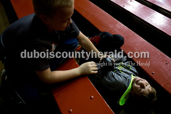 Caleb Hunbert, 10, reached for a toy ball from Zander Duncan, 10, both of Huntingburg, while playing together during Friday night's game against Boonville at Memorial Gym in Huntingburg. Southridge defeated Boonville 56-54. Tegan Johnston/The Herald