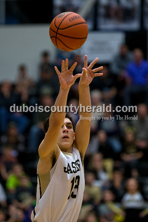 Jasper's Austin Simmers released a shot during Tuesday night's game against North Daviess in Jasper. The Wildcats won 60-48.   Alisha Jucevic/The Herald
