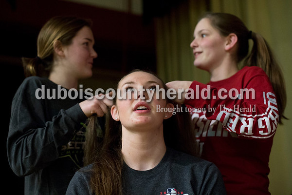 """Southridge High School freshmen Evie Sherer, left, and Audra Hochgesang braided the hair of freshman Paige Kendall before a """"Godspell"""" rehearsal at the school in Huntingburg on Tuesday. """"I think it's going to be a powerful show. We've all grown a lot. We've grown in theatre but also grown closer together,"""" said Paige. Sarah Ann Jump/The Herald"""