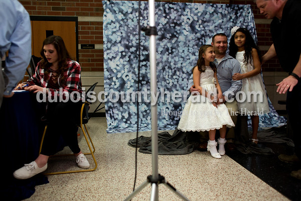 Tegan Johnston/The Herald Brian Barrix of Jasper was posed for a picture with his daughters Brianna, 8, left, and Jocelynne Calderon, 10, during the second annual Daddy and Daughter Dance on Saturday evening at Jasper Middle School in Jasper.  Dance Central Academy Parent Club sponsored the event that drew over 300 people.