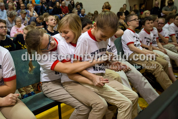 Huntingburg Elementary fifth-graders Ella Thompson, bottom, Kelsey Wibbeler and Kate Durcholz goofed around with one another as they waited for awards after the 21st Annual Indiana Academic M.A.T.H. Bowl at Cedar Crest Intermediate School on Thursday.    Alisha Jucevic/The Herald