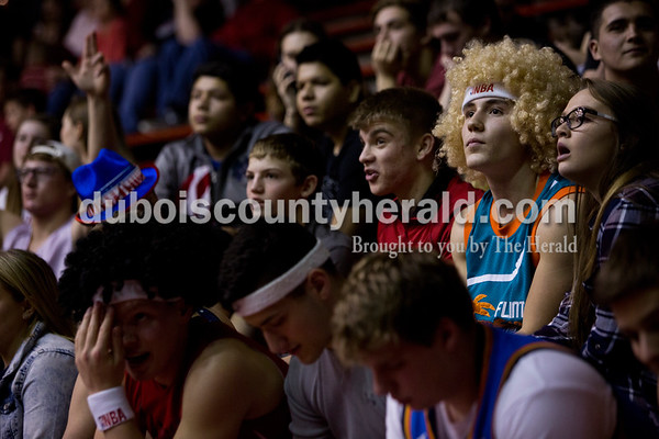 Southridge senior Isaac Englert, second from right, watched the game from the student section during Friday night's game against Boonville at Memorial Gym in Huntingburg. Southridge defeated Boonville 56-54. Tegan Johnston/The Herald