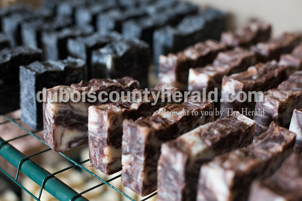 Sarah Ann Jump/The Herald Charcoal and chocolate peppermint soaps cure on a drying rack in the  home of Patty Ruhe near Maltersville on Monday.