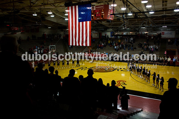 People stood for the playing of the national anthem before Friday night's game against Boonville at Memorial Gym in Huntingburg. Southridge defeated Boonville 56-54. Tegan Johnston/The Herald